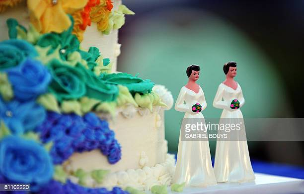 A wedding cake with statuettes of two women is seen during the demonstration in West Hollywood California May 15 after the decision by the California...