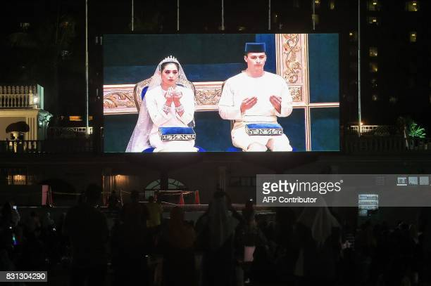 A wedding ceremony between Dutchman Dennis Muhammad Abdullah and Johor princess Tunku Tun Aminah Maimunah Iskandariah Sultan Ibrahim is projected on...