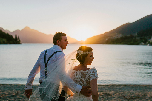 Wedding Couple by Queenstown Lake at Sunset