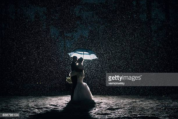 Wedding couple in the rain and snow