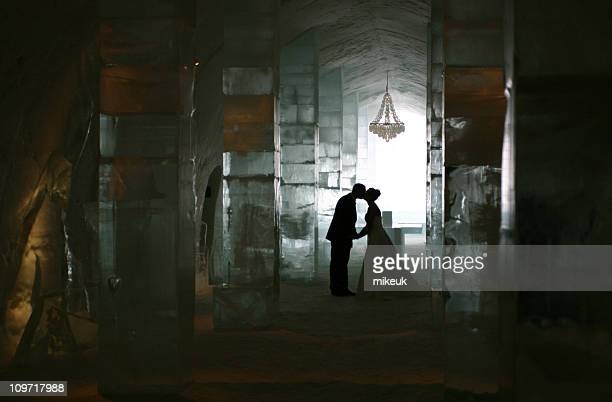 wedding couple kiss at the ice hotel, Kiruna, Sweden