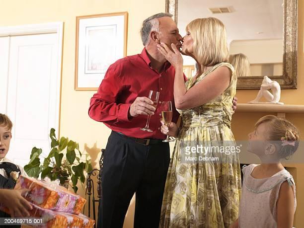 Wedding couple kissing indoors