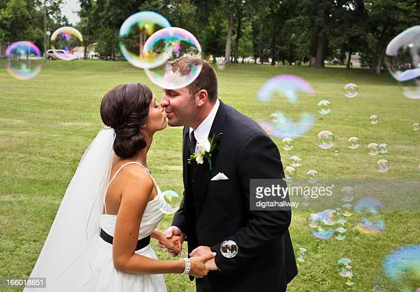 Wedding Couple Kissing Outdoors