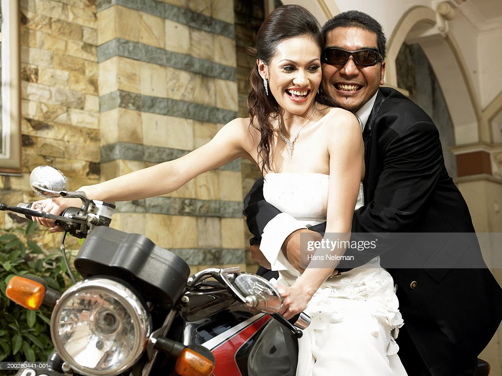 Wedding couple on motorcycle, woman driving : Stock Photo