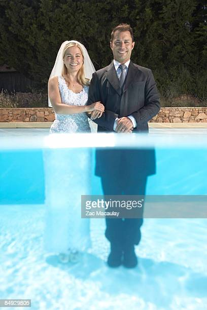 Wedding couple standing in pool
