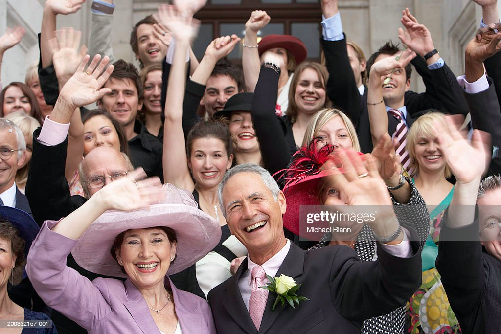 Wedding crowd waving and smiling, close-up