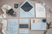 Beautiful vintage handwritten wedding calligraphy and decor details flatlay