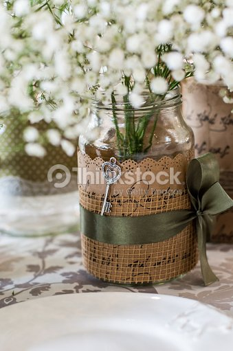 Wedding Decoration For Table White Flowers In The Glass Jar Stock
