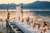Wedding dinner by the sea. Wedding banquet at the sea. Donja Lastva, Montenegro, Tivat.