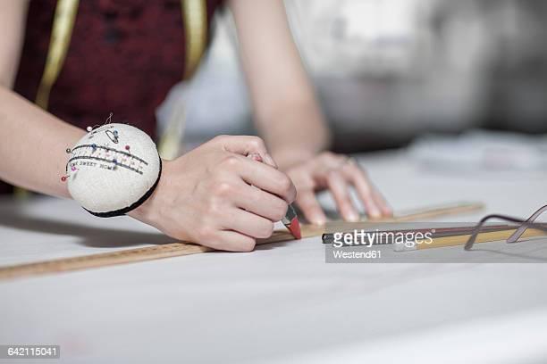 Wedding dress designer working