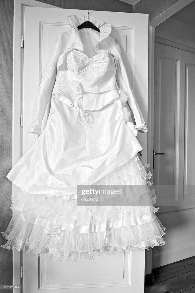 Wedding Dress Hanging On The Door Stock Photo
