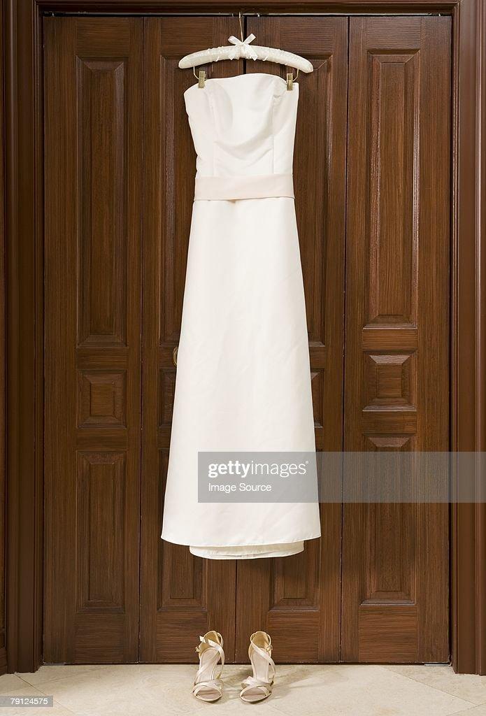 Wedding Dress Hanging On Wardrobe Stock Photo