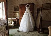 wedding dress in hotel room
