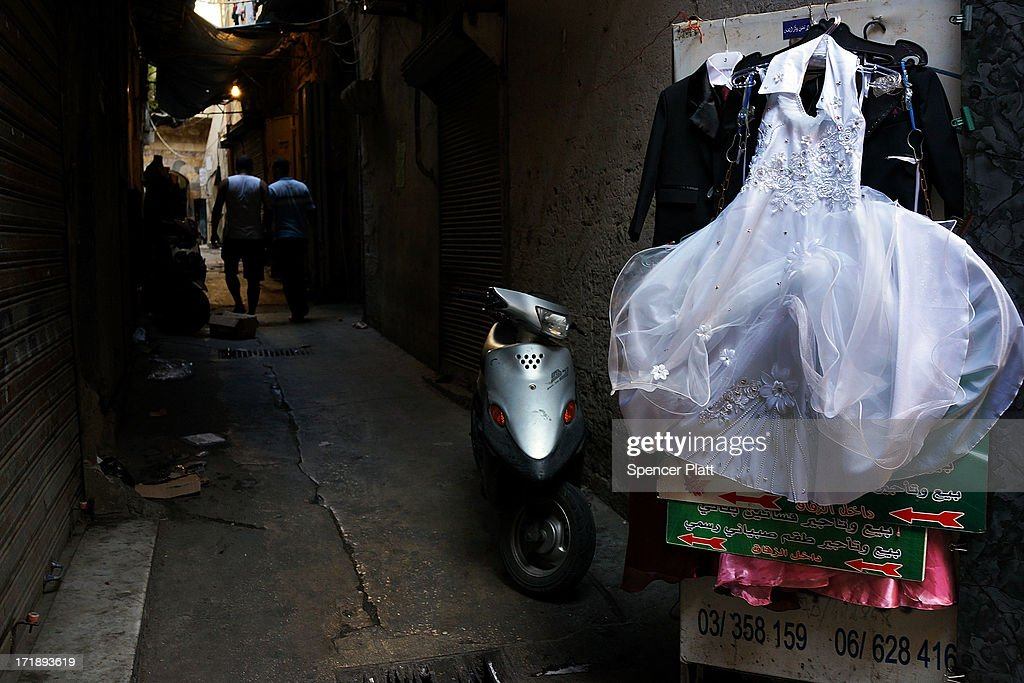 A wedding dress is hung out for sale in a market on June 29, 2013 in Tripoli, Lebanon. Tripoli, Lebanon's second largest city, has suffered from the spillover of Syria's two-year-old war. In the past month alone, over 30 people have been killed in Tripoli in battles between pro-Syrian government partisans against those supporting the Syrian rebels. Currently the Lebanese government officially hosts 546,000 Syrians with an estimated additional 500,000 who have not registered with the United Nations. Lebanon, a country of only 4 million people, is now home to the largest number of Syrian refugees who have fled the conflict. The situation is beginning to put a huge social and political strains on Lebanon as there is currently no end in sight to the war in Syria.