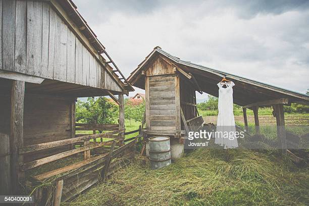 Wedding dress on barn.