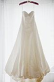Wedding dress on hanger, studio shot