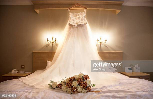 Wedding dress with flowers awaiting the bride