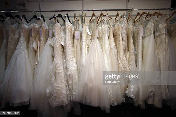 Wedding dresses are displayed at the London Wedding Show at ExCel on January 30 2016 in London England The show advertises numerous businesses...