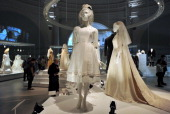 Wedding dresses are pictured during a press preview for an exhibition entitled 'Wedding Dresses 17752014' at the Victoria Albert Museum in London on...