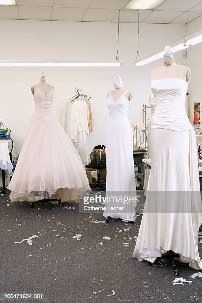 Wedding dresses on forms in factory