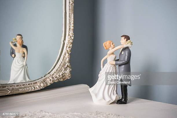 Wedding figurines and wall mirror