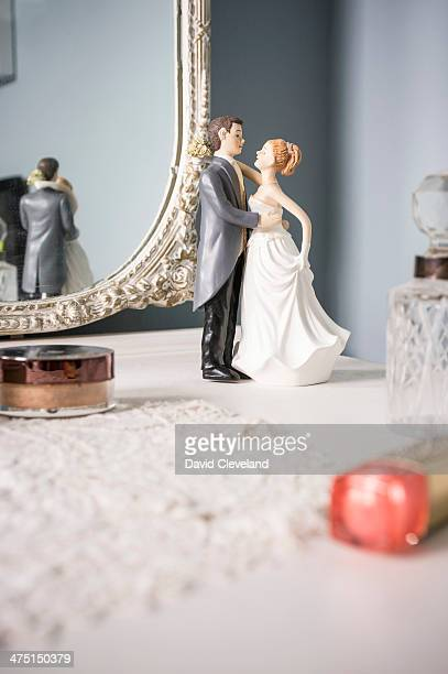 Wedding figurines on dressing table