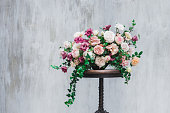 Wedding flower arrangement isolated on grey textured background