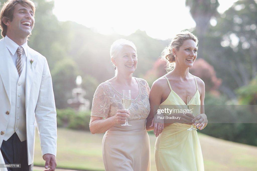 Wedding guests walking across lawn