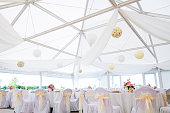 an image of tables setting at a luxury wedding hall - wide angle view
