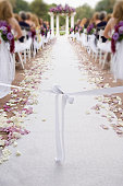 Wedding isle with bow and rose petals