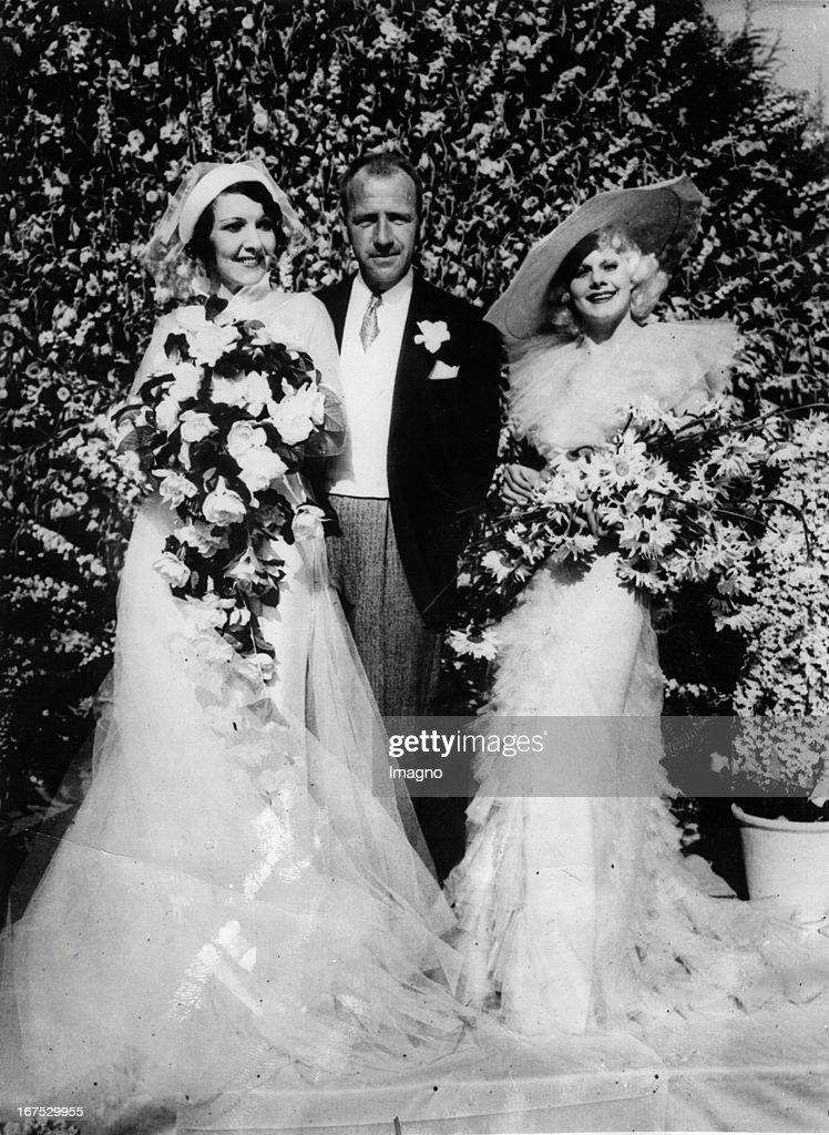 Wedding of actress Carmelita Geraghty and Carey Wilson. Beverly Hills. California. Right: the maid of honor: <a gi-track='captionPersonalityLinkClicked' href=/galleries/search?phrase=Jean+Harlow&family=editorial&specificpeople=70012 ng-click='$event.stopPropagation()'>Jean Harlow</a>. . Photograph. (Photo by Imagno/Getty Images) Hochzeit von Schauspielerin Carmelita Geraghty und Carey Wilson. Beverly Hills. Kalifornien. Rechts: Trauzeugin: <a gi-track='captionPersonalityLinkClicked' href=/galleries/search?phrase=Jean+Harlow&family=editorial&specificpeople=70012 ng-click='$event.stopPropagation()'>Jean Harlow</a>. 15.5.1934. Photographie.