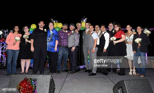 Wedding officiant Greg Chase poses with seven samesex couples from Nevada that he married at Las Vegas PRIDE's National Coming Out Day festival at...