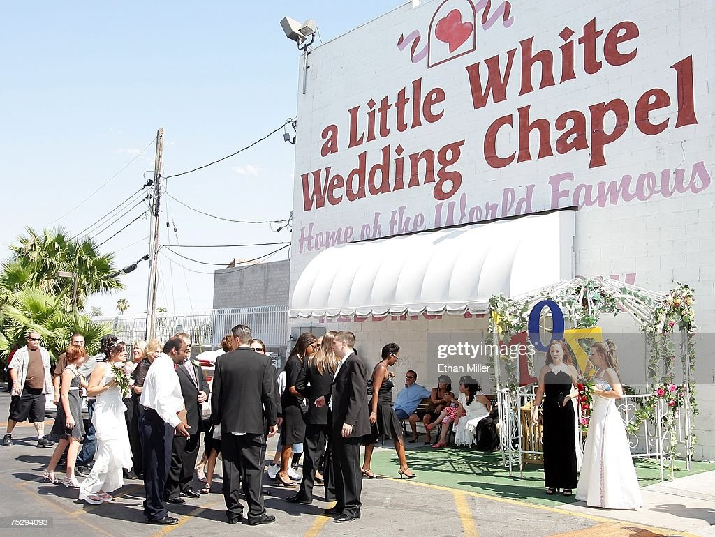 Wedding parties gather at the Little White Wedding Chapel July 7, 2007 in Las Vegas, Nevada. Wedding planners say a flood of couples are marrying on 7/7/07 due to the numerical and superstitious significance of the date.