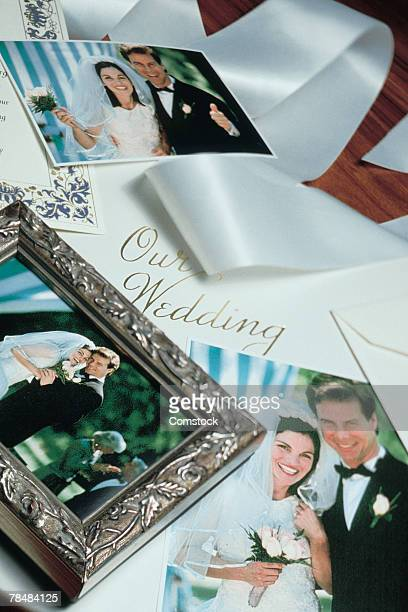 Wedding photos with ribbon and invitation