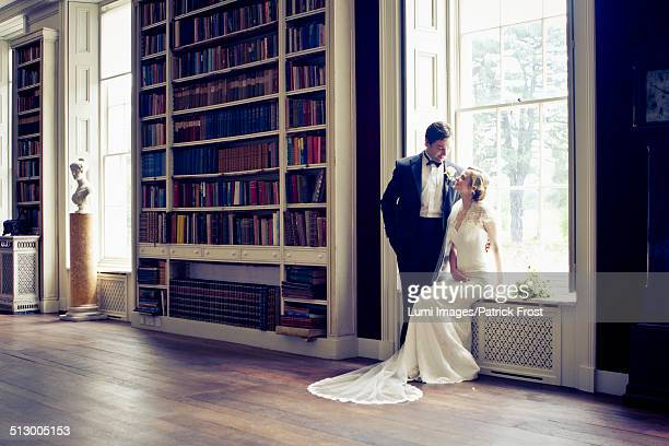 Wedding preparations, Bride and bridegroom in library, Dorset, England