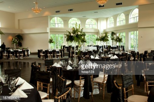 Wedding reception tables with floral centerpieces
