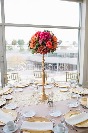 Wedding Reception Tables With Floral Centerpieces Stock Photo