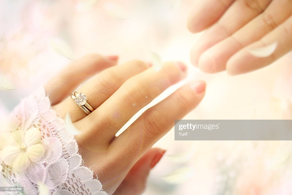 wedding ring and two hands stock photo getty images