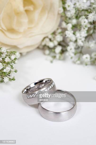 wedding ring and white rose
