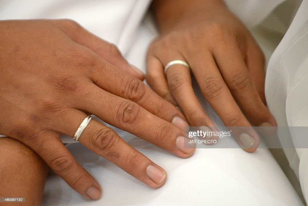wedding rings from a couple from the philippine navy and marines during a mass wedding sponsored - Military Wedding Rings