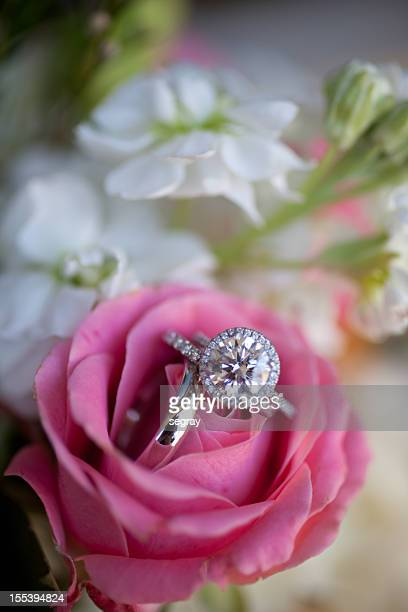 Wedding rings in a pink rose