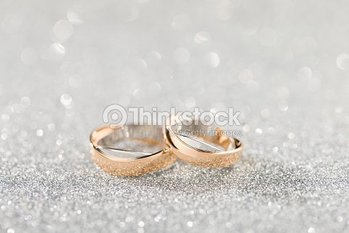 Wedding Rings On A Silver Sparkling Glitter Background With Bokeh
