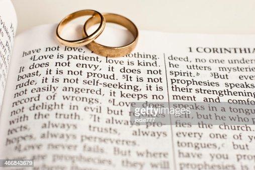 wedding rings on bible passage stock photo thinkstock