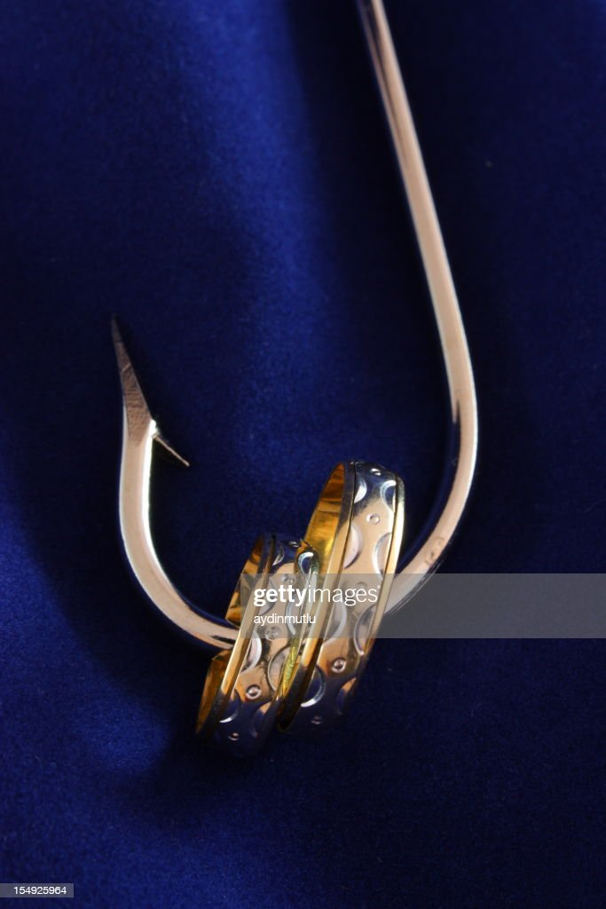 Wedding rings on fishing hook stock photo getty images for Fish hook wedding ring
