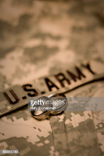wedding rings on us army acu uniform stock photo - Military Wedding Rings