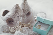 Beautiful gentle arrangement of lace silver high heels and bridal accessories for wedding.