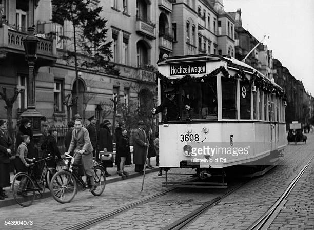 Wedding streetcar is passing throught the streets of Friedenau decorated with festoons and swastika flags at the occasion of the wedding of an...