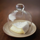 Wedge of Ripe Brie Under Glass Dome
