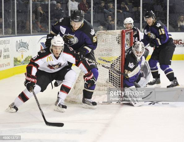 Wednesday December 14 2011 Portland Pirates vs the Manchester Monarchs hockey Portland's MarcAntoine Pouliot carries the puck around the back of the...