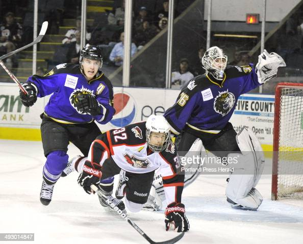 Wednesday March 28 2012 Portland Pirates vs Manchester Monarchs at the Civic Center Pirate Ryan Duncan got tripped up by Monarch Nick Deslauriers in...
